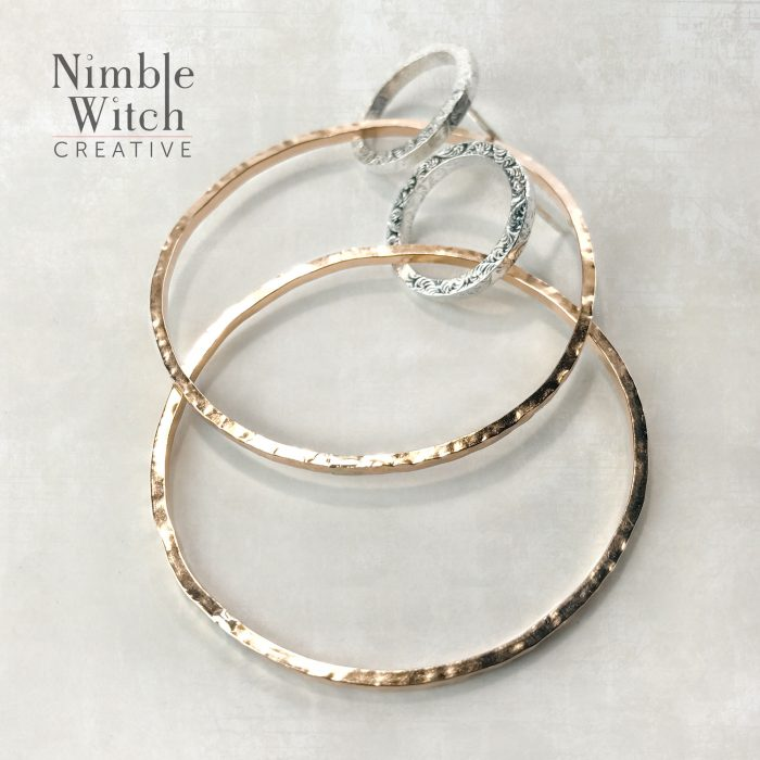 Double hoop earrings in silver and gold