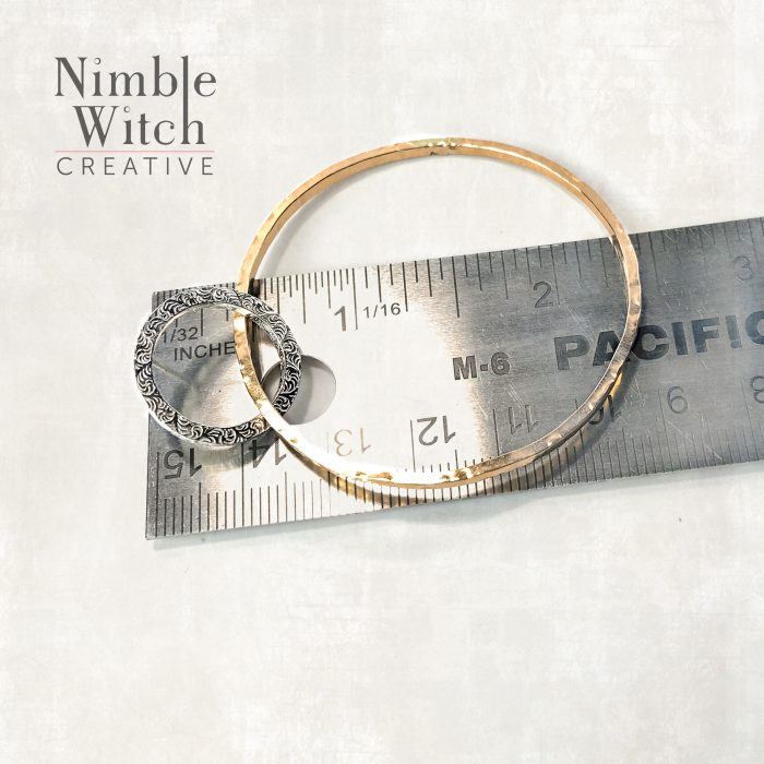 Double hoop earrings with ruler for size