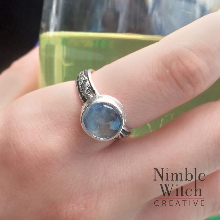 Moonstone ring on model.