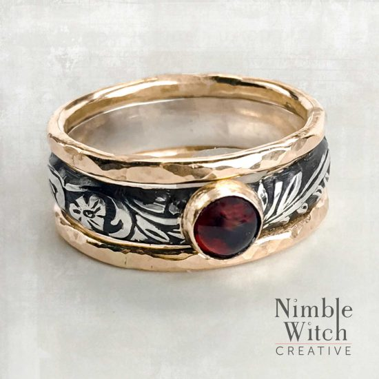Garnet 3-ring set in gold and silver